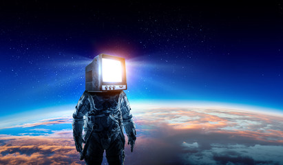 Astronaut with TV head in space. Mixed media.