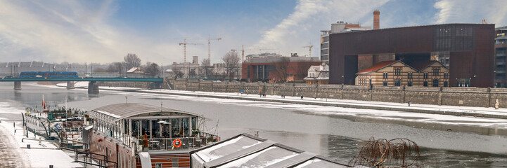 KRAKOW, POLAND - JANUARY 23, 2017: Barges on Wisla river on cold winter day Fototapete