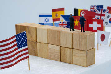 USA China and multi countries flags with wooden fence. It is symbol of America first policy and tariff trade war.-Image.