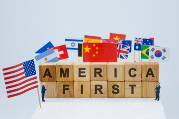 America first wording with USA China and multi countries flags. It is symbol of America first policy and tariff trade war.-Image.