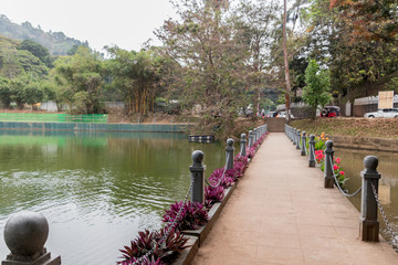 Bridge and river in Kandy, Sri Lanka with flowers and nature.