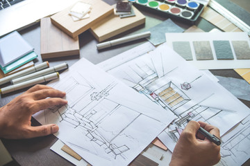 Architect designer Interior creative working hand drawing sketch plan blue print selection material color samples art tools Design Studio Wall mural
