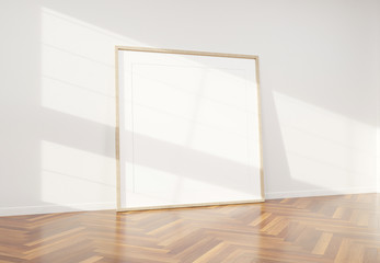 Wooden frame leaning in bright white interior with wooden floor mockup 3D rendering