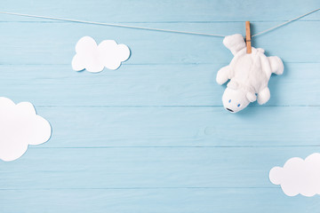 Baby boy background with white teddy bear toy on a clothesline and clouds Fototapete