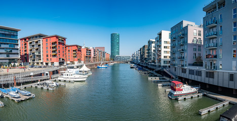 Frankfurt Westhafen with modern architecture, small harbor and residential buildings