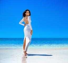 Sensual, elegant woman on a tropical beach
