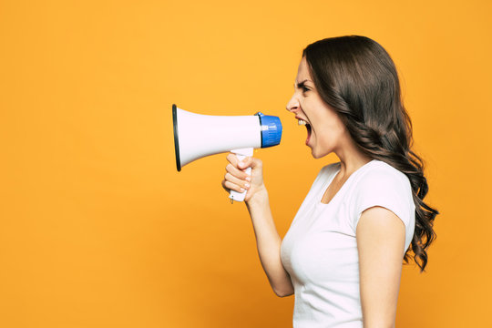 Going on rant. Vibrant orange background with an angry girl next to it who is loudly screaming and using a megaphone for it.
