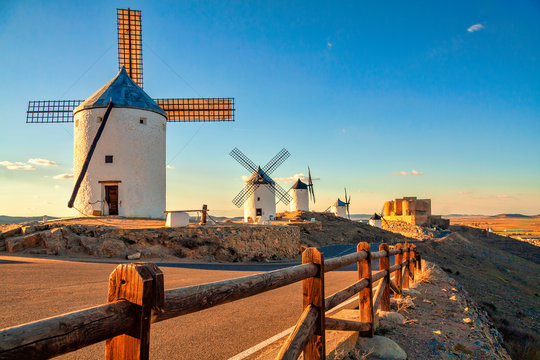 Spanish windmills and medieval castle on a hill in Consuegra, Toledo, Spain.