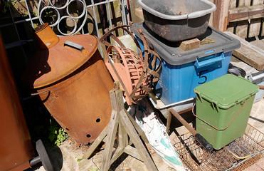 accumlation of trash in corner of a garden in Burnley in Northern England
