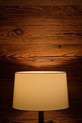 Light of a floor lamp on the wooden wall