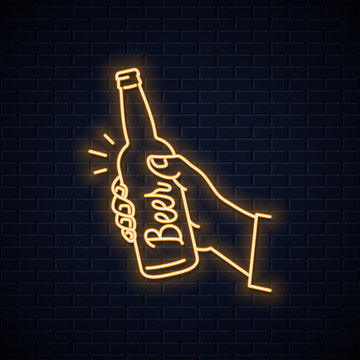 Hand hold beer bottle neon sign. Male a beer