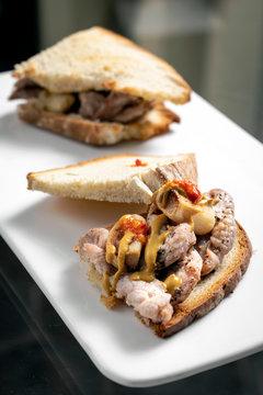 famous traditional portuguese bifana pork sandwich snack in lisbon cafe