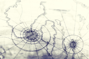 Closeup of old map for travel concept background. Vintage and retro backdrop.
