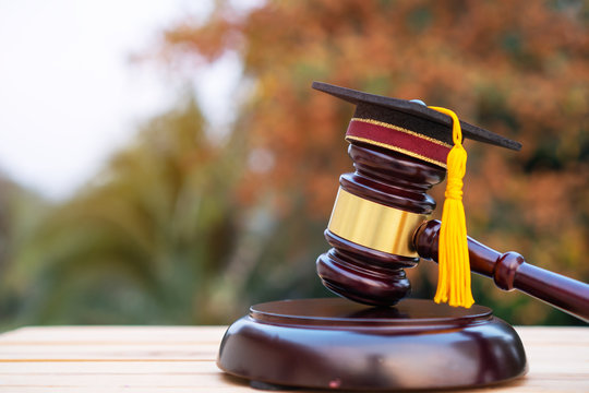 Graduation diploma hat / Judge gavel on school lawyer. Concept of graduate study international abroad about jurisprudence laws certificate in university, distance education for learning by self
