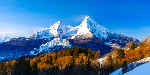 Beautiful winter wonderland mountain scenery in the Alps with pilgrimage church of Maria Gern and famous Watzmann summit in the background, Berchtesgadener, Bavaria, Germany Fototapete