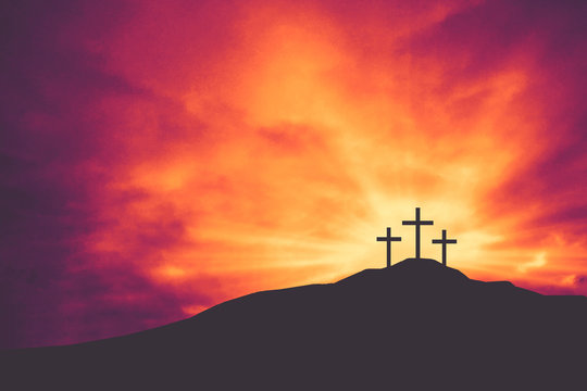 Three Christian Easter and Good Friday Holiday Crosses on Hill of Calvary with Colorful Clouds in Sky - Crucifixion of Jesus Christ Background