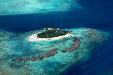 aerial view of tropical paradise maldives island resort with coral reef turquoise blue ocean tourism background