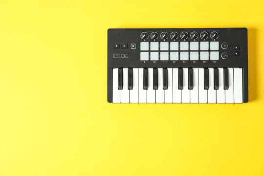 Midi keyboard on color background, space for text