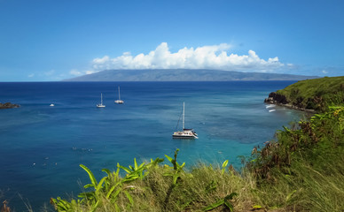 Panoramic view of boats in bay, blue ocean, blue sky, green shore, paradise in Maui, Hawaii