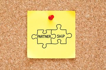 Partnership Jigsaw Puzzle Concept Sticky Note