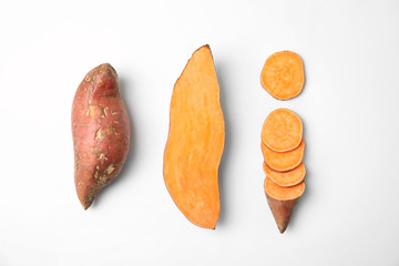 Composition with sweet potatoes on white background, top view Wall mural