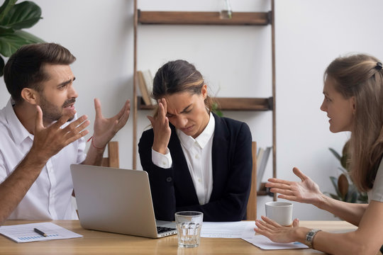 Stressed annoyed office employee having headache migraine at business meeting