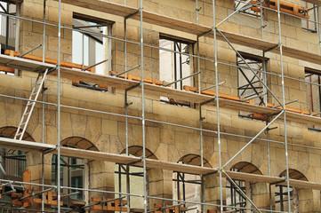 scaffold at facade of empty historic building