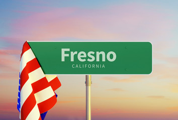 Fresno - California Road or Town Sign. Flag of the united states. Sunset oder Sunrise Sky