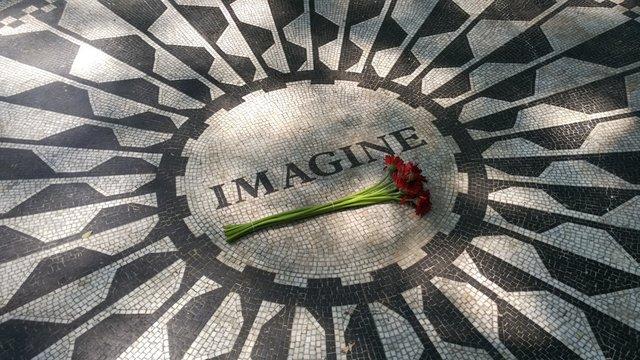 Black and white Imagine mosaic for memory John Lennon. Red flower. Strawberry Fields in Central park. New York city. USA