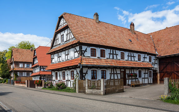 Traditional half-timbered houses in the streets of the small town of Hunspach in Alsace