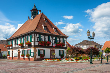 Traditional half-timbered houses in the streets of the small town of Seebach in Alsace