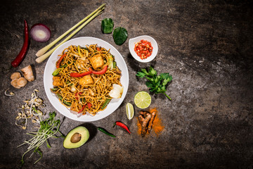 Vegetarian tofu asian food background with various ingredients on rustic stone background , top view.