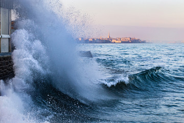 A wave breaks in Saint-Malo