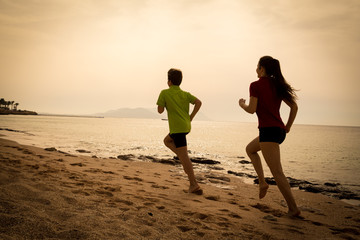 Two kids running together at morning exersises, sepia toned