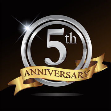 5th anniversary logo, with shiny silver ring and gold ribbon isolated on black background. vector design for birthday celebration.