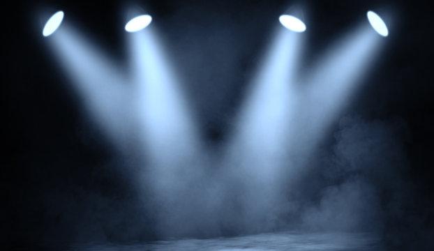 Blue studio spotlight . Stage with smoke on the floor