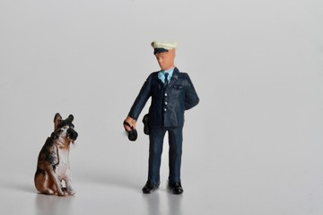 policeman miniature with a police dog and some suspect powder