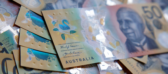 Australian fifty dollar banknote. The new 2019 issue bill is designed to deter counterfeiting, the note is polymer and water resistant with a clear holographic strip in a web banner format.