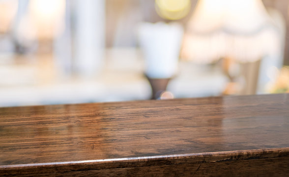 wood table at restaurant blur background.Empty perspective hardwood bar with blur coffee shop with bokeh light,Mock up for display or montage of product,Banner or header for advertise on online media