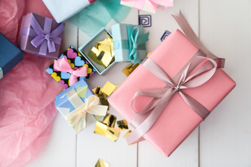 Different gift boxes on white table