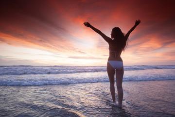 Woman at sea sunset