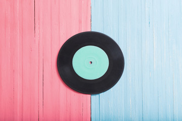 Music records on pink and blue wooden background. Retro music concept