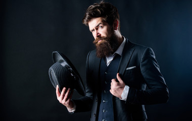 Elegant and stylish hipster. Retro fashion hat. Man with hat. Vintage fashion. Man well groomed bearded gentleman on dark background. Male fashion and menswear. Formal suit classic style outfit