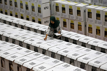 An official prepares ballot boxes in a warehouse in Jakarta