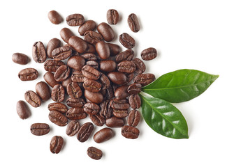 Heap of roasted coffee beans and leaves