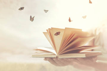 surreal moment of freedom for butterflies coming out of an open book