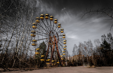 Old ferris wheel in the ghost town of Pripyat. Consequences of the accident at the Chernobil nuclear power plant