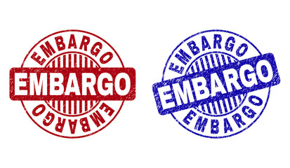 Grunge EMBARGO round stamp seals isolated on a white background. Round seals with grunge texture in red and blue colors. Vector rubber overlay of EMBARGO tag inside circle form with stripes. Wall mural