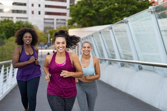Group of natural women jogging