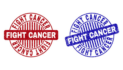 Grunge FIGHT CANCER round stamp seals isolated on a white background. Round seals with grunge texture in red and blue colors.